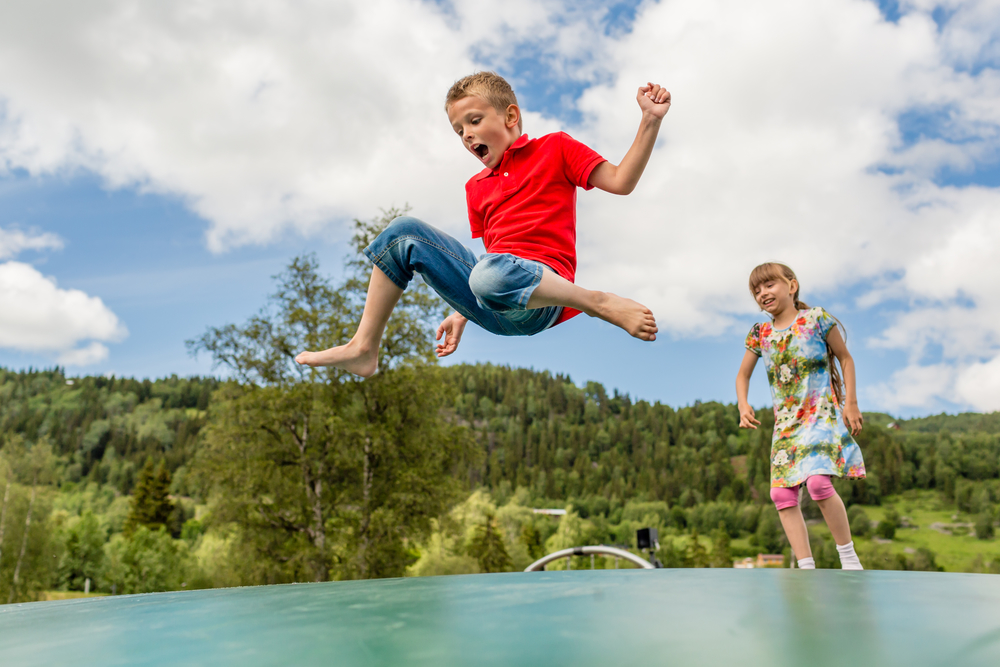 Young Boy and girl on a trampoline