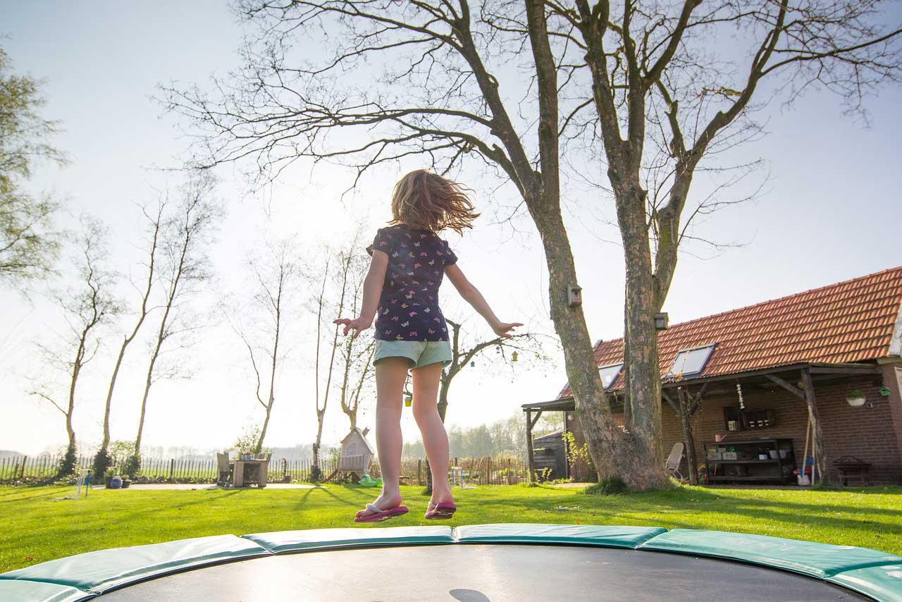 girl jumping on round trampolines