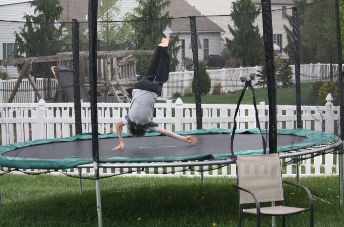 Boy is doing some mini trampoline workout
