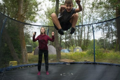teenagers playing on trampoline